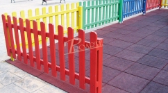 Fence in coloured wood